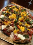 Grilled pizza with mango and Italian sausage